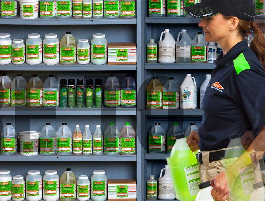 SERVPRO Employee hard at work with cleaning supplies in hand