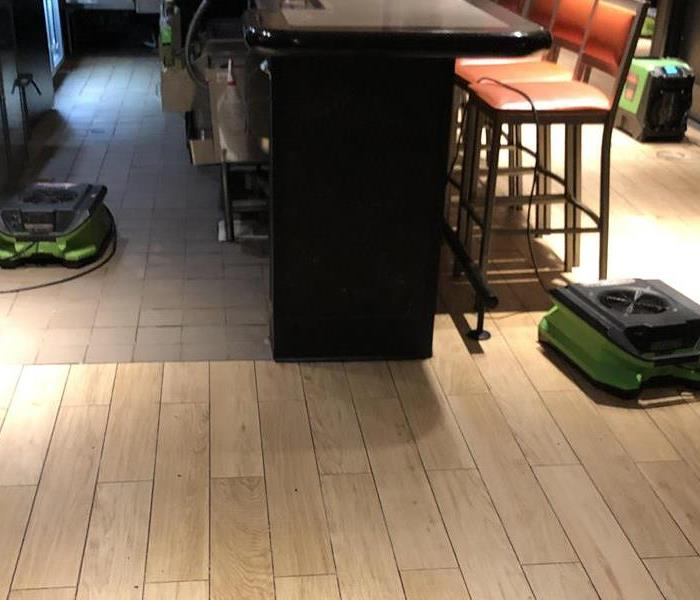sewage and broom on floor
