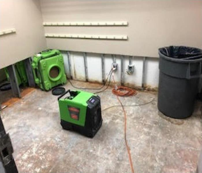 green equipment cut walls